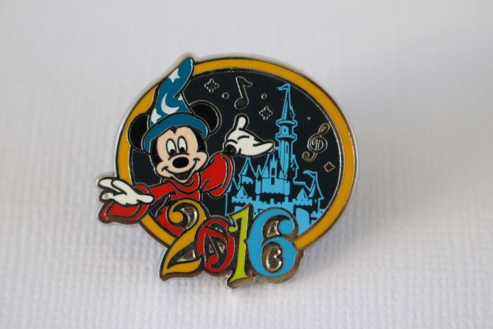 This Disney Pin for sale features Sorcerer Mickey Mouse from Fantasia. He's in the Magic Kingdom, in front of Cinderella's Castle, and commemorates the year 2016 in Walt Disney World Florida. Guarante