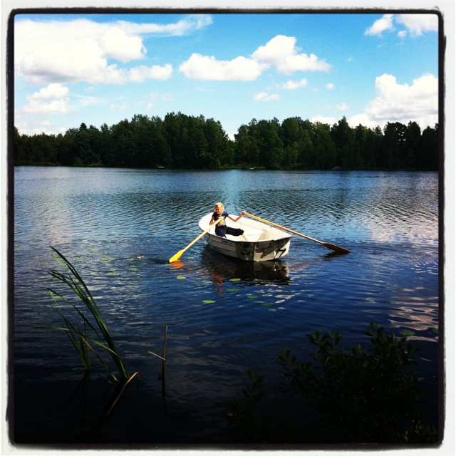 Lieke gryning out our new boat in the lake by our cottage in Småland, Sweden.