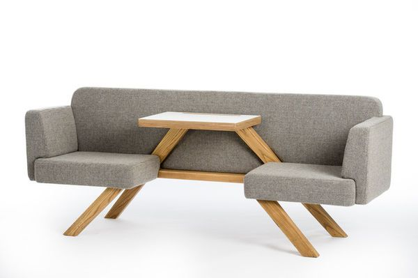 This is an interesting design.  It reminds me of my sketches for a conversation chair, with a table in the middle.