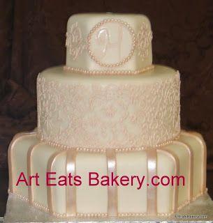 Custom round and hexagon ivory and champagne monogram and lace fondant wedding cake design