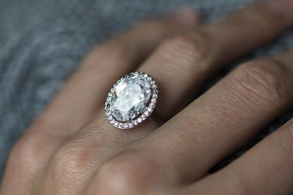 Large sparkly moissanite engagement ring with halo set diamonds. This ring is definitely eye catcher:) CERTIFIED Forever Brilliant Moissanite Round