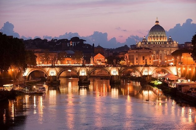 A view of St Peter's Basilica in Rome and a bridge over the River Tiber. More cathedral photos here: http://in.lifestyle.yahoo.com/photos/the-world-s-great-cathedrals-slideshow/