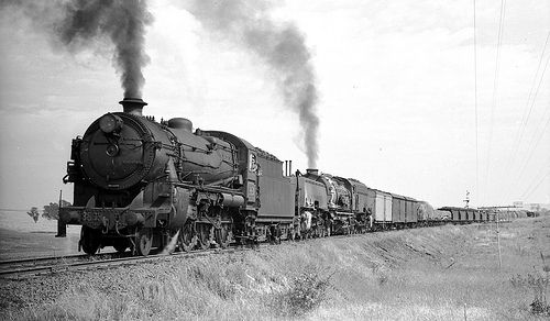 New South Wales Government Railways (NSWGR) steam locomotives 3639 + Beyer Garratt 6020 up goods just east of the Gamboola crossing loop between Molong and Orange, N.S.W, Australia.