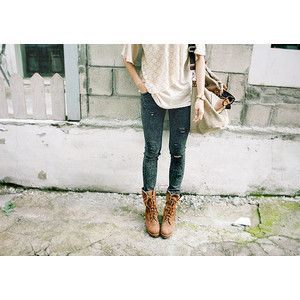 Layered texture tops distressed jeans combat boots and over sized bag