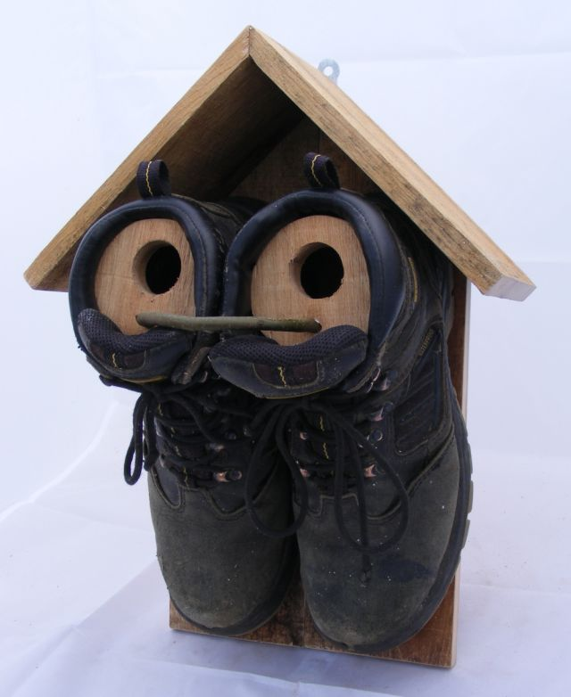 Sparrow nest box using an old pair of work boots and pallet wood.