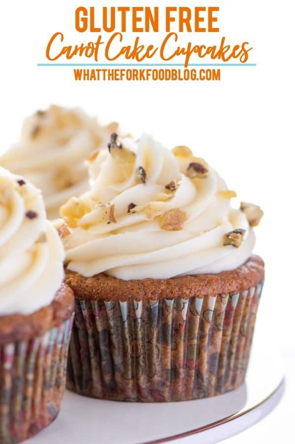 These gluten free carrot cake cupcakes are based off of everyone's favorite spring cake just now in cupcake form! Great to add to dessert tables for Easter, baby showers, bridal showers, or even birthday parties. These cupcakes are loaded with carrot, pineapple, coconut, and walnuts and topped with cream cheese frosting. Recipe from @whattheforkblog | whattheforkfoodblog.com | gluten free cupcake recipes | how to make carrot cake cupcakes | #glutenfree #dessert #cupcakes #carrotcake…