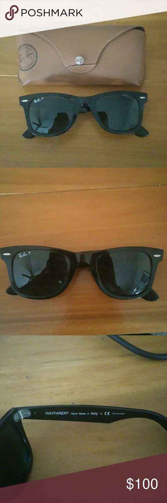 Ray-Ban Wayfarer Polarized This is the glossy black wayfarer model with emerald tinted polarized lens. They are in good condition with minor cosmetic damage that cannot be seen unless you are holding them up to the light. The lens are in good condition with no scratches.The case has a crack in the leather on the front. The wayfarer is a one size fits all unisex sunglass. I am selling this item because they do not fit me well and I want to get new sunglasses. I am also open to trades for…