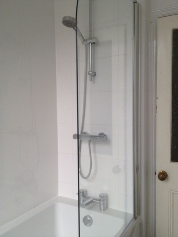 White Tiles, White Grout & White Silicone in a Bathroom Installation by UK Bathroom Guru