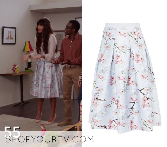 """Tahani Al-Jamil (Jameela Jamil) wears this silver floral blossom printed structured midi skirt in this episode of The Good Place, """"Dance Dance Resolution"""". It is the Ted Baker Pallye Oriental Blossom Full Skirt."""