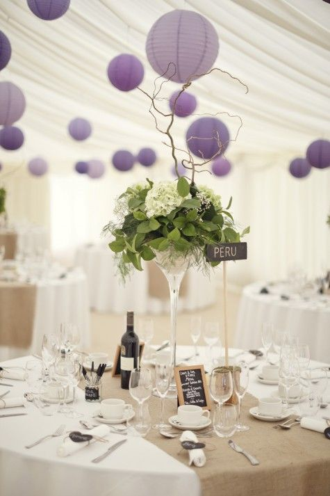 Boho Planned Weddings: Claire and Tom's Natural and Modern Wedding by Mark Tattersall. Love the centerpieces and the purple lanterns.