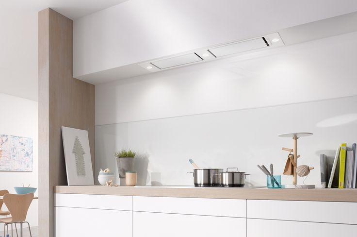If you are opting for a minimal kitchen design, a hood integrated into a run of units is the ultimate concealed extractor - as seen here in this simple yet stunning Scandi-feel kitchen