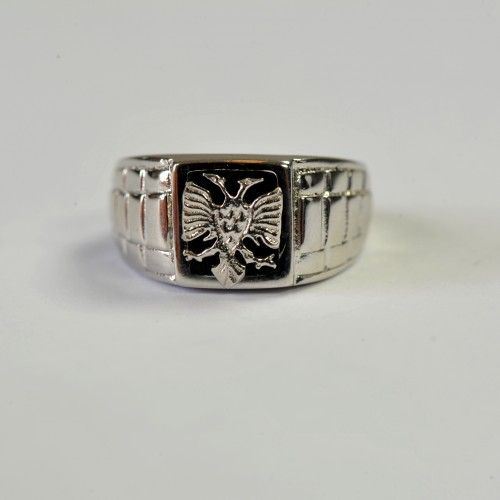 Unique handmade ring for men made of silver. It has the eagle crafted on it with a black background.