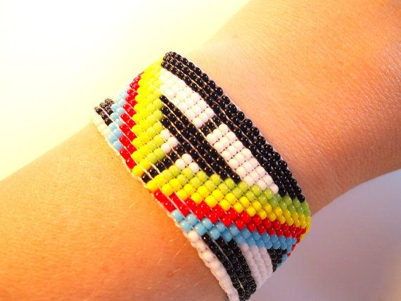 Hey, I found this really awesome Etsy listing at https://www.etsy.com/listing/481095853/triangle-color-loom-bracelet-unique
