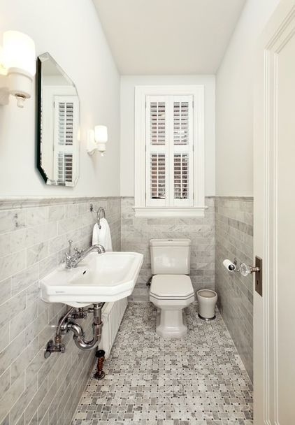 Make a tiny bath or powder room feel more spacious by swapping a clunky vanity for a pared-down basin off the floor