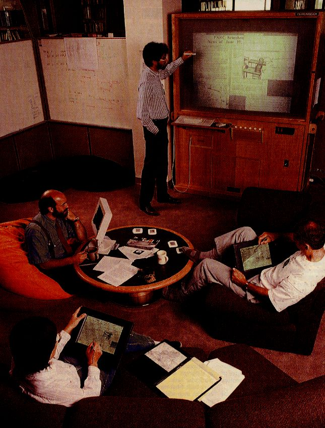 Mark Weiser and his team using prototype tabs, pads and a board at Xerox PARC in 1990/91.