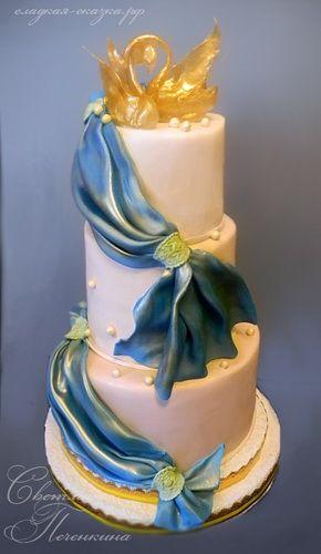 Свадебный торт с карамельными лебедями