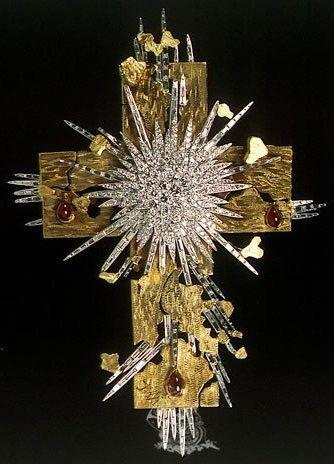 The Light of Christ by Salvador Dali, 1953, 18 karat yellow gold, platinum forming rays, natural rubies, diamonds.