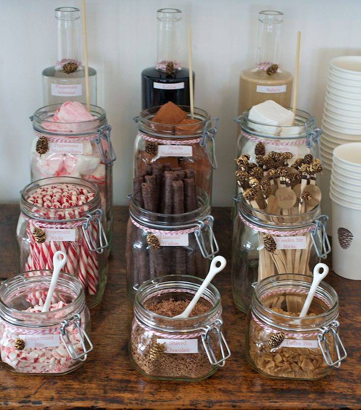 custom hot cocoa bar for winter party...  peppermint schnapps, kahlua, bailey's, peppermint marshmallows, mocha marshmallows, vanilla marshmallows, peppermint stir sticks, hazelnut wafer sticks, wooden stir sticks, peppermint crumbs, shaved chocolate, toffee crumbs =  yum.