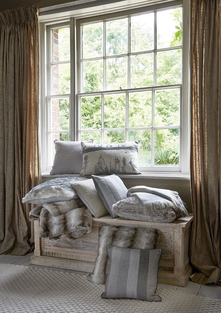Soft fur throws and neutral coloured cushions will add warmth to your home this Autumn.