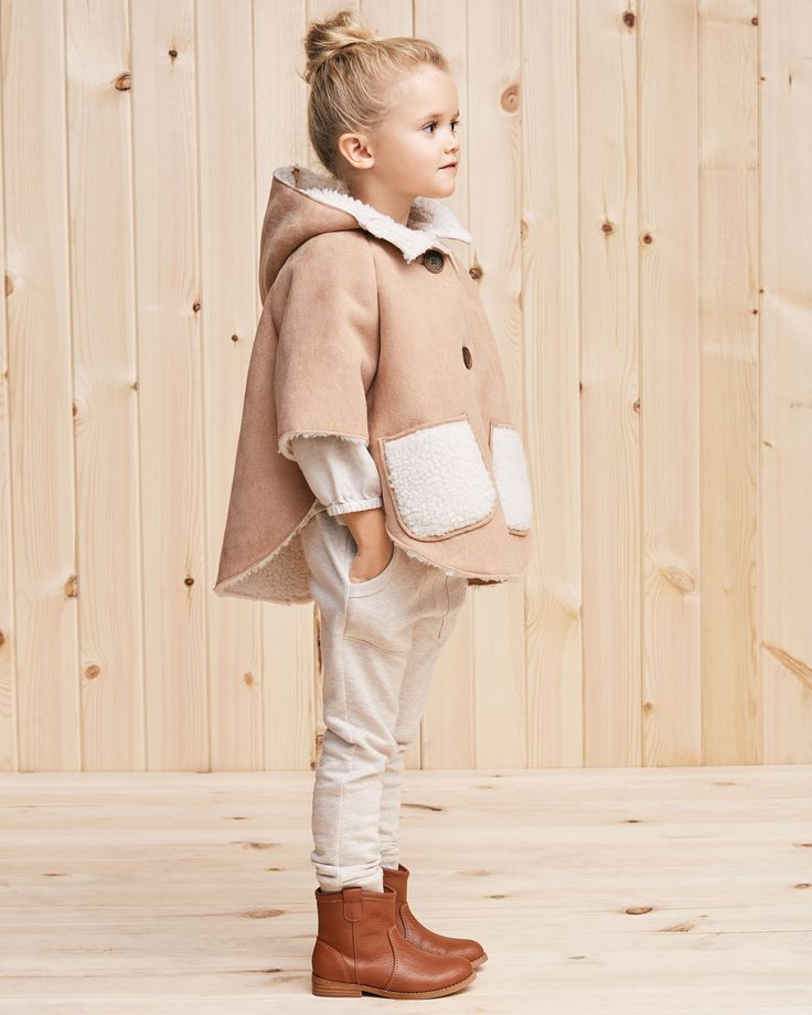 A perfect layer for cooler days, it has faux shearling lining so it's extra warm and cosy. The oversized buttons and contrast patch pockets add a little fun. #countryroadstyle #countryroadchild