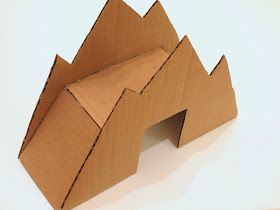 glue your cardboard toy mountain bridge together
