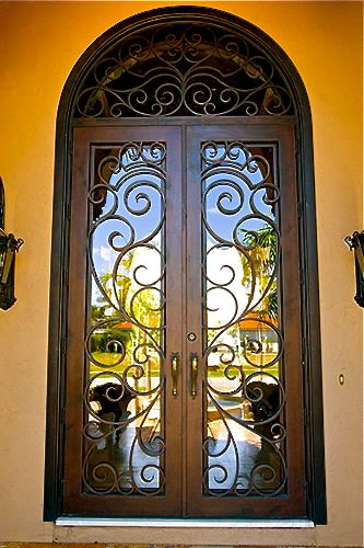 The coolest custom doors EVER!!!!!!  http://clarkhalldoors.com/details.aspx?cat=3&class=863