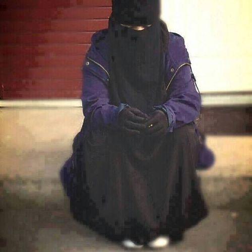 Niqabi sitting on a bench