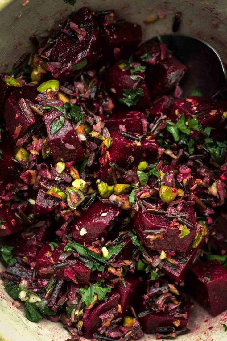 An earthy, filling wild rice salad using beets, and toasted pistachios paired with parsley and a lemon vinaigrette. A perfect lunch or picnic salad!