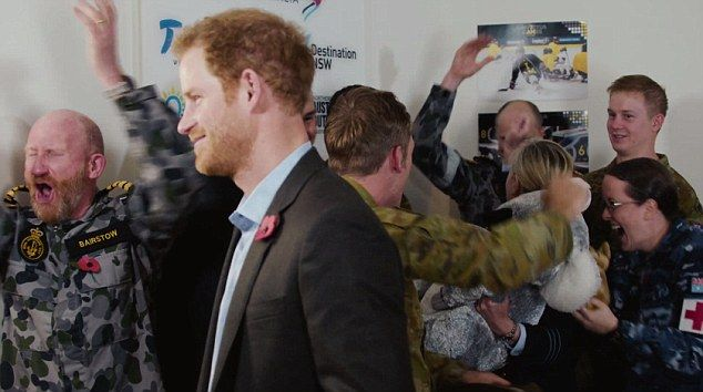 In Prince Harry's video announcement, Australian military personnel cheer...