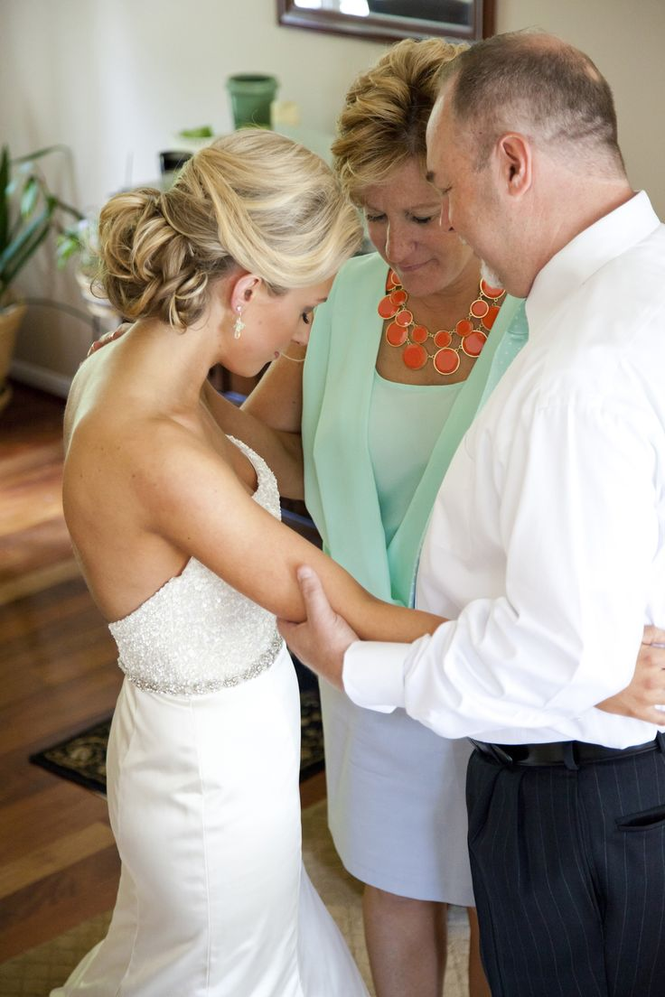 Praying before wedding picture with mom and dad.