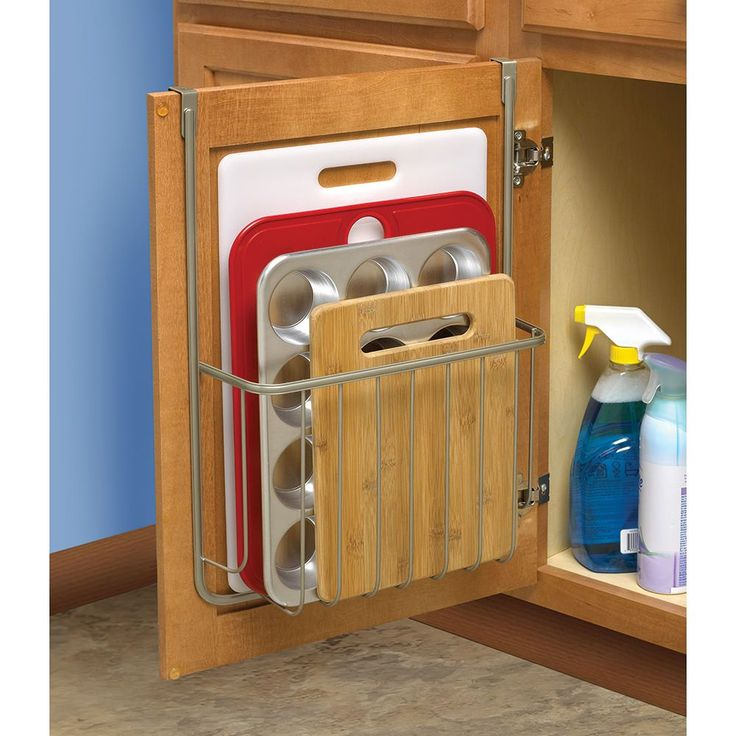 Hangs over cabinet door to maximize storage.