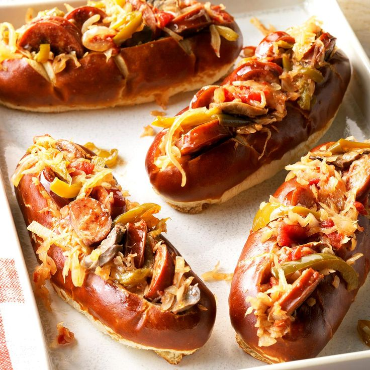 """Sausage and Kraut Buns Recipe -This recipe has become a regular at our church potlucks. Let's just say I'm """"in trouble"""" if I show up at a get-together and they don't appear! For a fun dinner spin, try these sausages and kraut over mashed potatoes. —Patsy Unruh, Perryton, Texas"""
