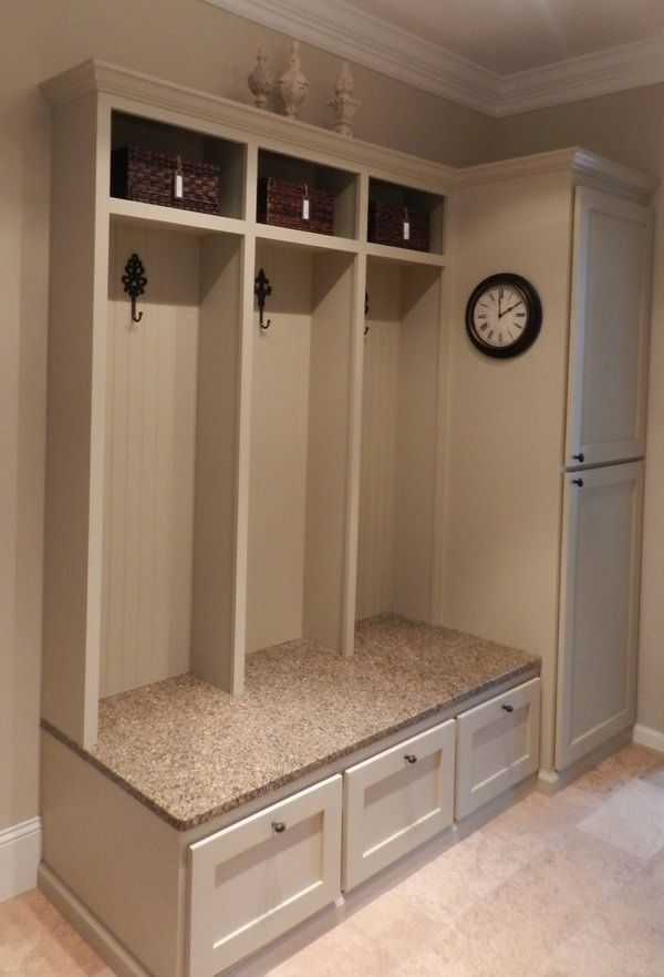 Functional cabinet. A little bench provide convenience when you put on or take off your shoes. A few hooks for hunging up the purses and jackets. Brown baskets above for scarves and gloves, leashes and miscellaneous paraphernalia.