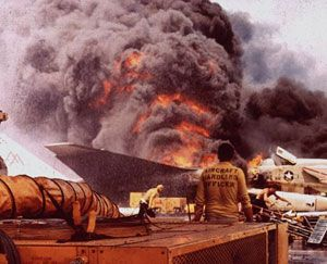 The USS Forrestal, with burning planes on deck, is shown in a 1967 file photo. The Navy's worst disaster since World War II claimed the lives of 134 sailors.