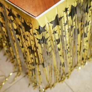 Metallic Gold & Black Star Table Skirting Great for Hollywood Theme Party by Biestle. $19.15. Great for Hollywood theme party. 14 ft. X 30 in. (76 cm x 4.3 m). 1-PLY METALLIZED PVC FRINGE 14 ft. X 30 in. (76 cm x 4.3 m)