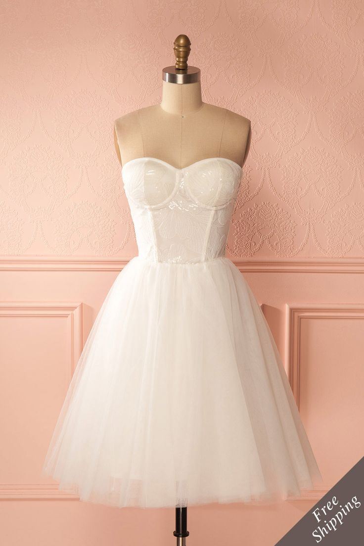 Salvanie - Inspired by Odette in Swan Lake, this lovely bridal dress has a soft, flowing tulle skirt and a bustier style bodice.  #promdresses #bridesmaid