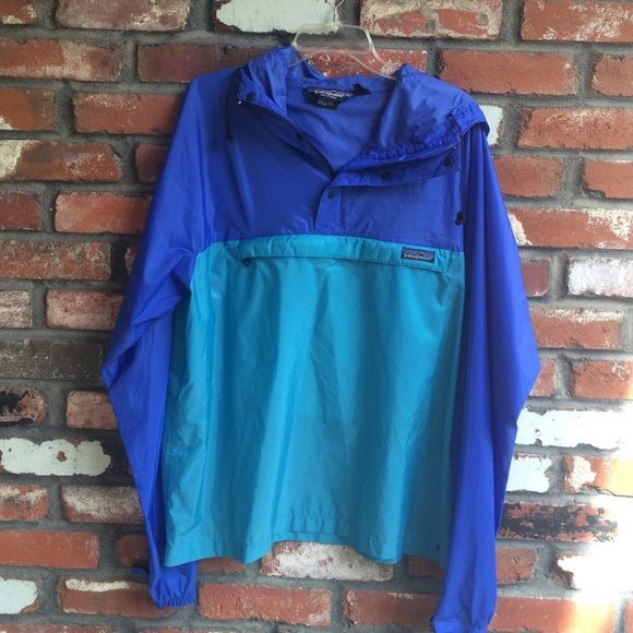 Patagonia rain jacket Hoodie.  Amazing vintage coat in good used condition!  Stains, holes, rips or smells.  The bottom may have had a tie at one point but it is no longer there!  Cobalt blue and turquoise with a front pocket.  100% lying!  Super cool! Patagonia Jackets & Coats