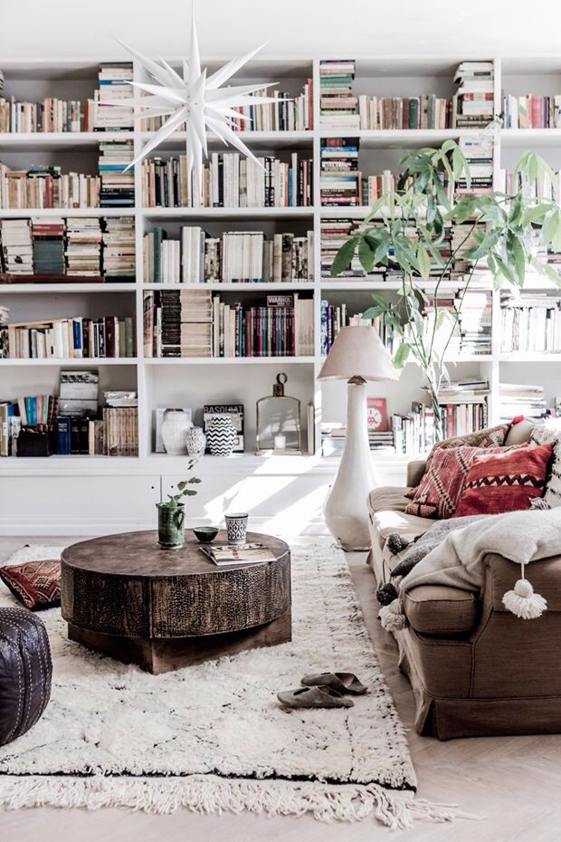 modern global style. White, minimal, earthy. Wall-to-wall built-in bookshelves