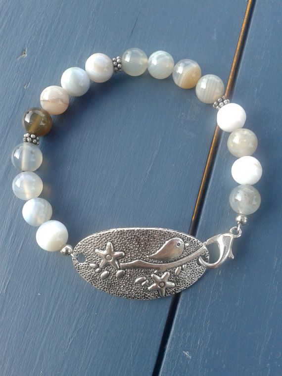 Hey, I found this really awesome Etsy listing at https://www.etsy.com/listing/183845690/blue-gray-agate-bird-bracelet