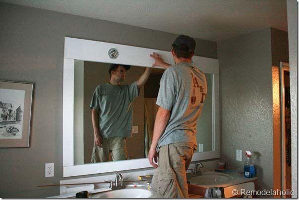 DIY for bathroom mirror: http://www.remodelaholic.com/2012/11/framing-large-bathroom-mirror/