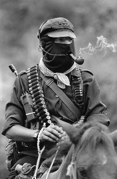 fyeah-history:  Subcomandante Marcos, the spokesman of the Zapatista Army of National Liberation, smoking a pipe atop a horse in ChiapasSubcomandante Marcos is the spokesperson for the Zapatista Army of National Liberation (EZLN), a Mexican rebel movement. In January 1994, he led an army of Mayan farmers into the eastern parts of the Mexican state of Chiapas in protest of the Mexican government's treatment of indigenous peoples.