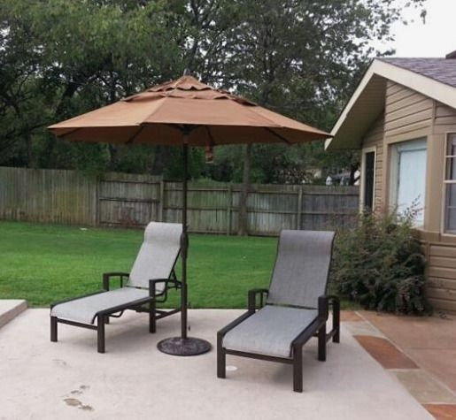 tropitone lakeside sling chaise lounge chairs under a 9u0027 treasure garden umbrella enjoy your outdoor