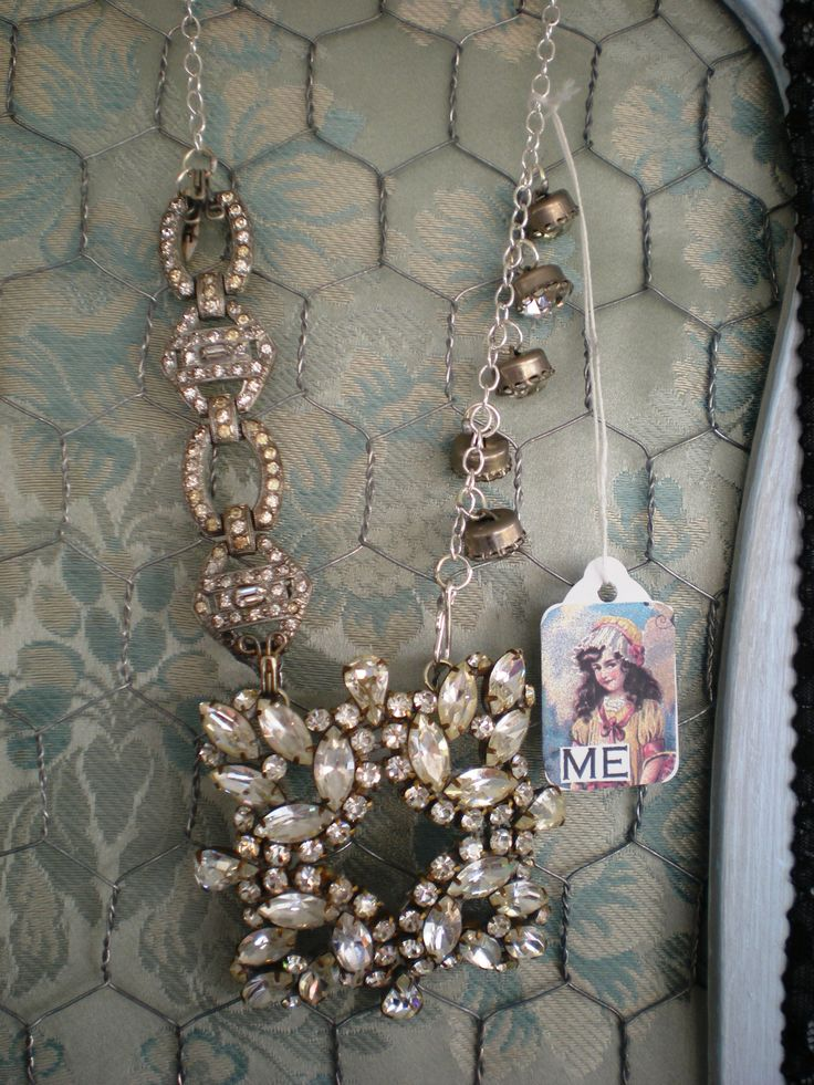vintage fur lip pin turned into a pendant for a necklace with vintage bracelet parts and vintage rhinestone buttons.