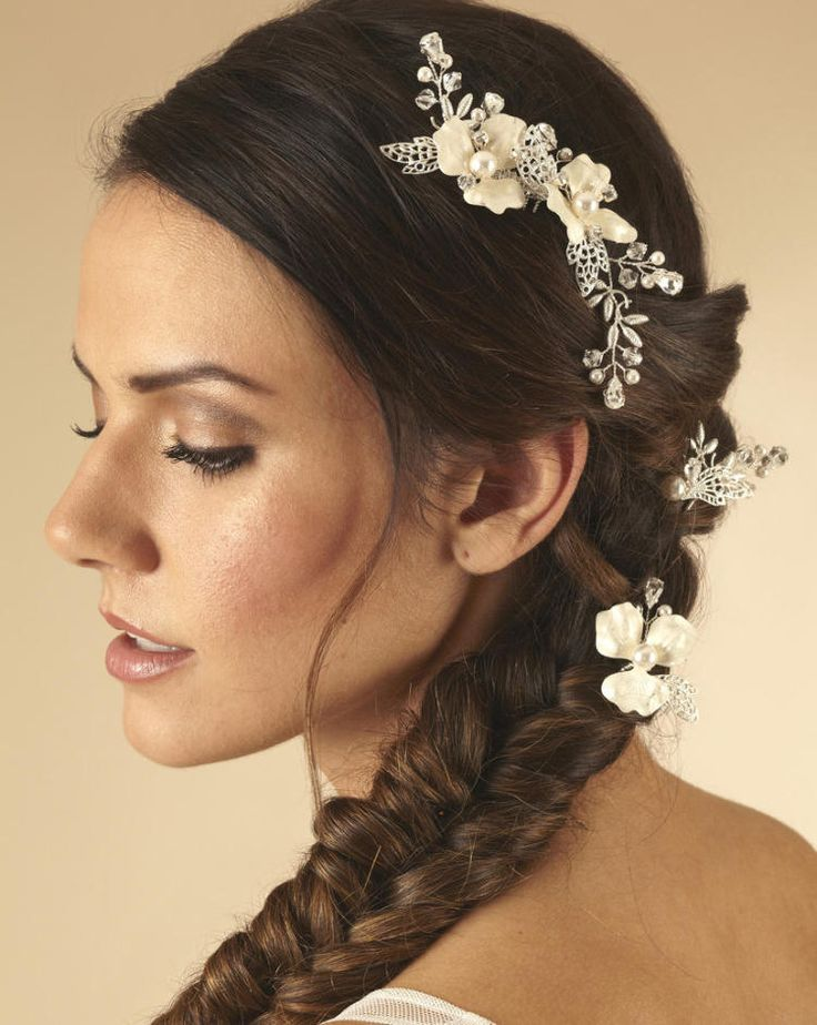 Bridal Headpiece- AR527 is a beautiful hand enamelled floral comb with two matching hair pins. Wear around a bun, scattered through an updo or cascading down a side plait (shown).