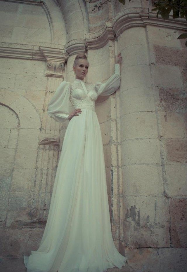 High neck long sleeve modest wedding gown.  This collection of beautiful wedding dresses for special divas is work of the most popular Israeli designers Yaki Ravid.