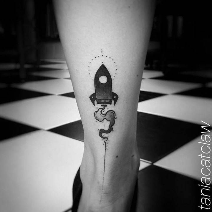 Small rocket tattoo on the right Achilles heel.