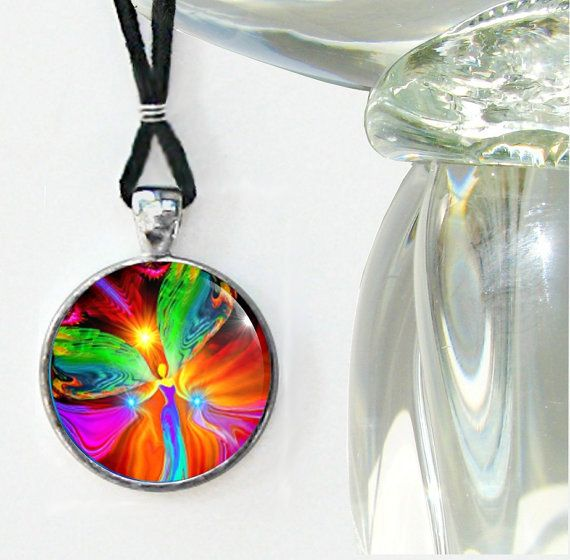 This is a reiki energy healing pendant necklace in my angel themed line of chakra jewelry. This handmade unique wearable art necklace can be used
