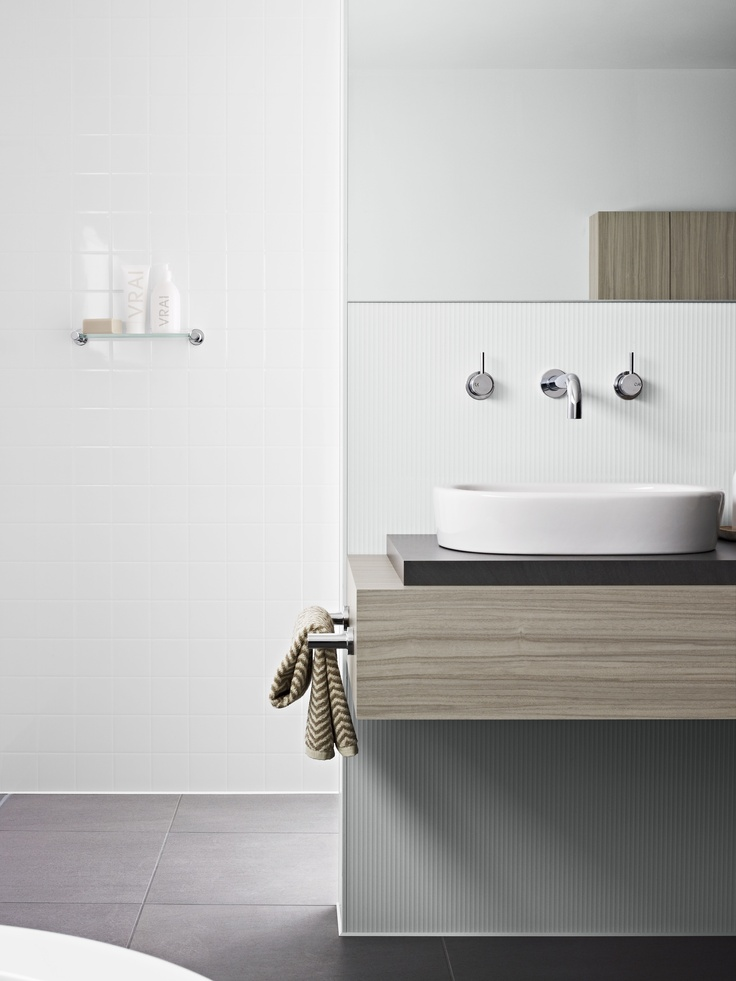 Back wall and shower panelling Laminex Aquapanel Polar White Large Tile. Basin wall Laminex Aquapanel Polar White Ripple. Basin bench Laminex  Colour Palette Avignon Walnut and raised basin setting Laminex Colour Palette Evening Shale. Styling Wendy Bannister. Photography Earl Carter.