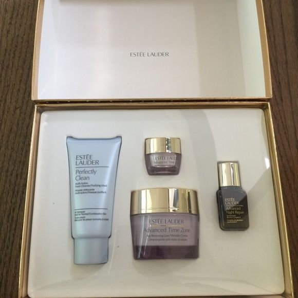 NEW Estée Lauder makeup set Gift set includes perfectly clean cleanser, advanced time zone eye cream & full size face cream, and an advanced night repair. Comes in a sparkly gold box. Product sizes are: Perfectly clean cleanser: 50 ml Advanced night repair: 15ml Advanced time zone age reversing line/wrinkle creme: 50 ml Advanced time zone eye cream: 5 ml Estee Lauder Makeup