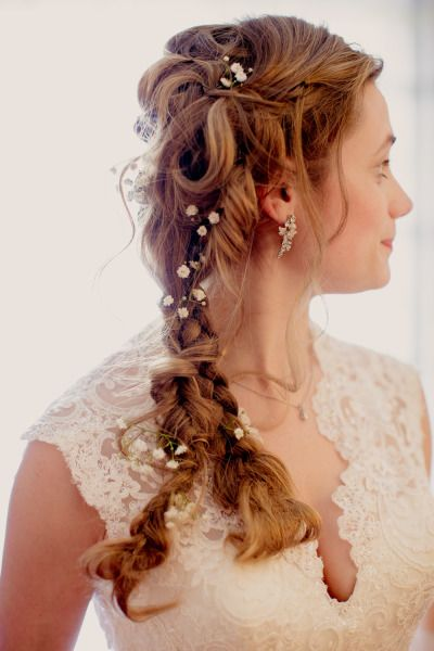 Baby's breath braided into this wedding hair: http://www.stylemepretty.com/illinois-weddings/beach-park/2013/11/25/midsummer-nights-dream-wedding-from-kristin-la-voie-photography/ | Photography: Kristin La Voie - http://kristinlavoiephotography.com/